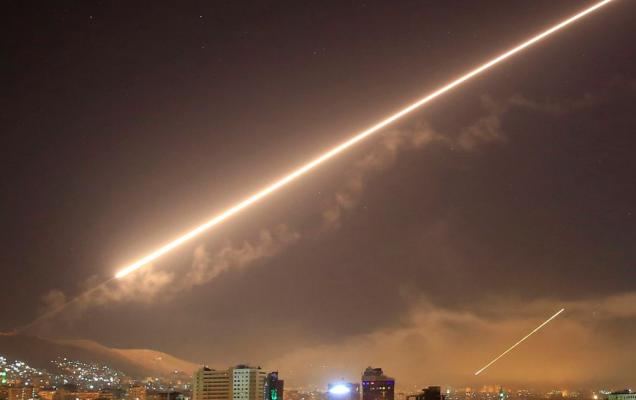 an air-strike in Syria Credit: Hassan Ammar/AP